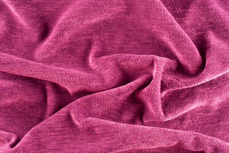 Textile and texture concept - close up of crumpled fabric background. Abstract background, empty template. Top view.