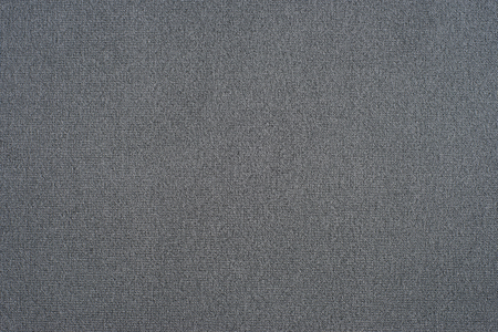 Gray fabric texture. Abstract background, empty template. Top view.