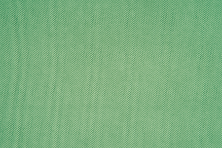 Green fabric texture background. Abstract background, empty template. Top view. Stock Photo