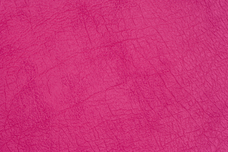 Genuine leather texture, bright pink, crimson color, matte surface, trendy background. Concept of shopping, manufacturing, modern backdrop pattern banner design