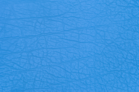 Surface faux leather with creases in blue color as background or texture. Top view. Stock Photo - 121452612