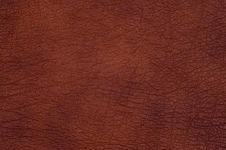 Ausführliche Nahaufnahme des natürlichen dunklen Lederzusammenfassungshintergrundes. Ansicht von oben. Standard-Bild