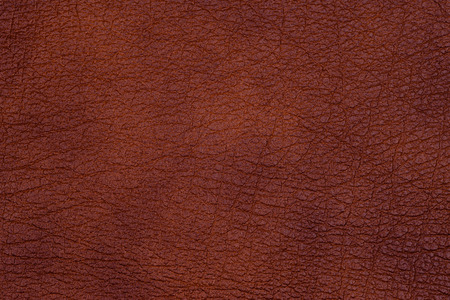 Natural dark leather abstract background detailed closeup. Top view.