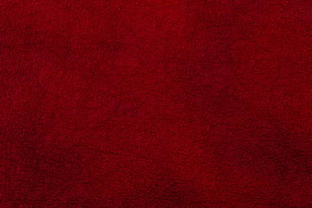 Dark red leather surface as a background, leather texture. Skin Reklamní fotografie