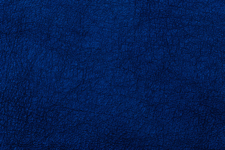 Dark blue textured leather background. Abstract leather texture. Top view.