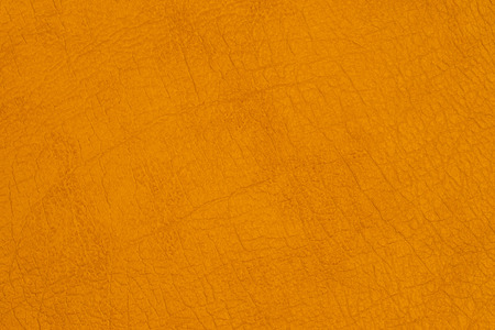 Yellow leather texture background, skin texture background. Top view.