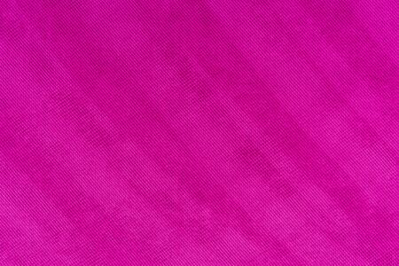 Magenta colored fabric. Cloth background. Natural fabric. Fuchsia colored fabric. Fabric texture. Fabric background.