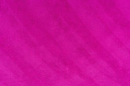 Magentafarbener Stoff. Stoff-Hintergrund. Natürlicher Stoff. Fuchsiafarbener Stoff. Stoff Textur. Stoff Hintergrund.
