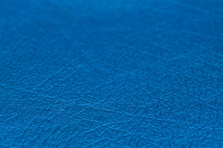 Close up of natural blue leather background. Selective focus