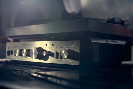 Music amplifier for vinyl player, turntables. Old school. musical atmosphere. Old player and analog music. macro photo.