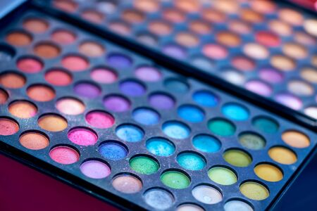 Packaging with multi-colored shadows for makeup. The Politra of Shadows for the Ages. The girl will become more beautiful. For facial care. Beauty and health