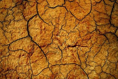 Edad de Piedra: goldish fondo abstracto textura de piedra agrietada