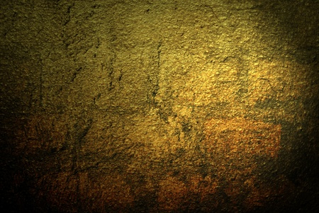 goldish: abstract background goldish stone wall texture Stock Photo