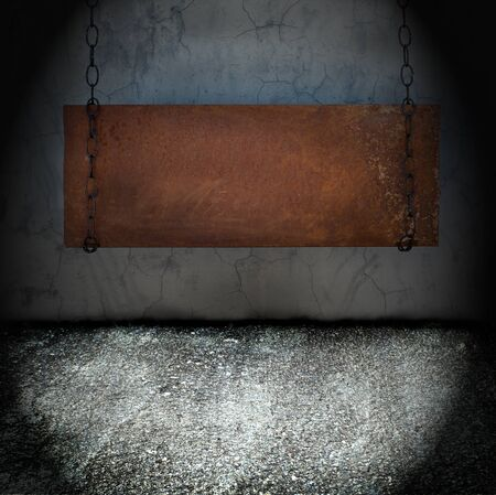 Metal banner hanging in a dark grungy room Stock Photo - 12951536