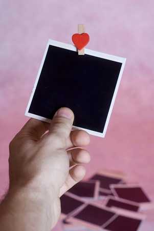instant photo in hand isolated on pink background  photo