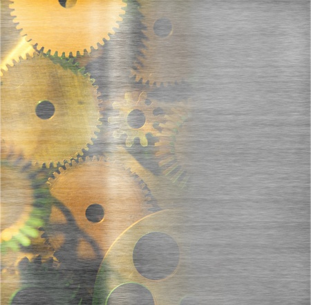 large industrial gears set against titanium and in gold metallic  photo