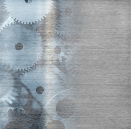 large industrial gears set against titanium and in silver metal  photo