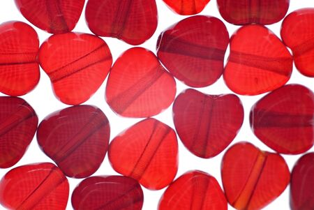 red heart beads isolated on white photo