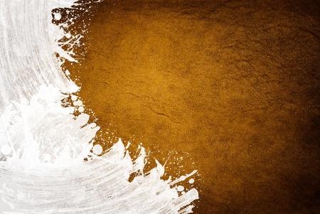 dark golden leather texture with splash paint photo