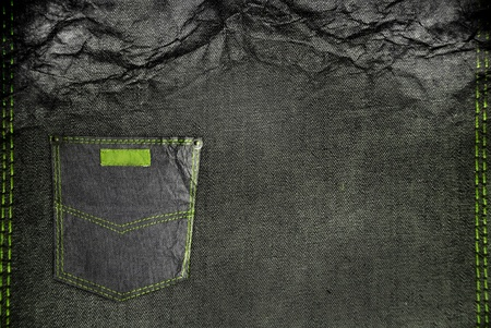 crushed jean with a pocket and green stitch photo