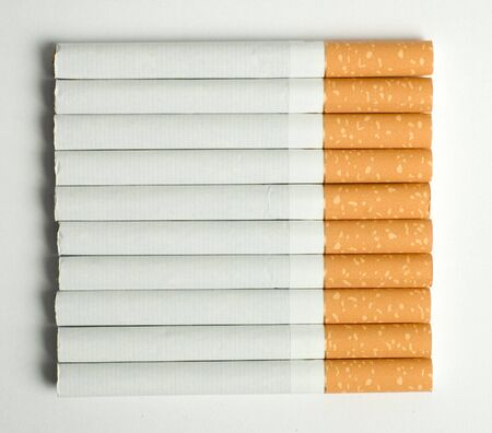 quiting: ten cigarettes isolated on the white background Stock Photo