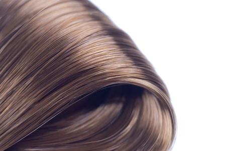 Lock of silken brown hair isolated on white background  Stock Photo