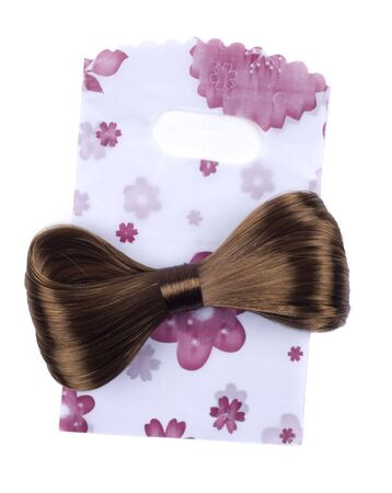 hair bow: hair-pin from hairs with a package isolated on a white background