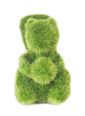 toy of squirrel from artificial grass isolated on white background photo