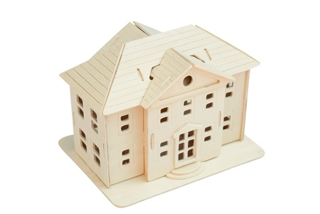 Wooden toy house on a white background. Isolated path included photo