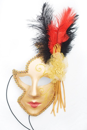 golden carnival mask isolated on white photo