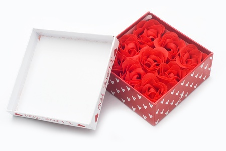 openly: gift box with rose isolated on white Stock Photo