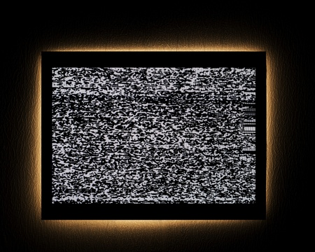 illuminated wall: tv with emby light on dark wall Stock Photo