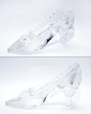 cinderella shoes: woman glass shoe with reflection isolated on black background  Stock Photo