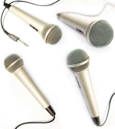 radio microphone: A dynamic mic with a curled cable over white.