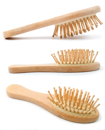 Wooden old comb with hair isolated on white  photo