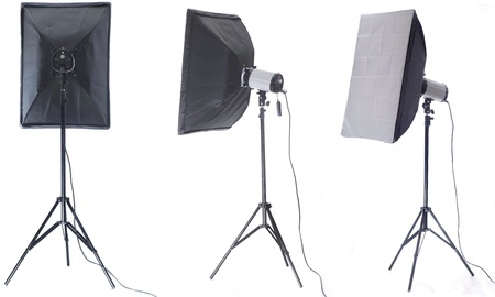 Studio flash with soft-box isolated on a white background photo