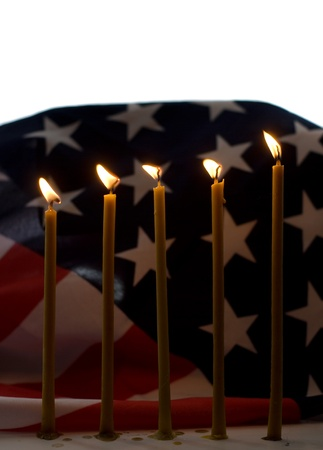 memorial candle: Lighted candle with an old American flag