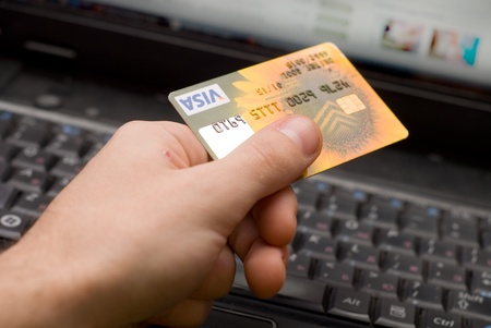 bank transfer: credit card in hand for purchases are in the internet