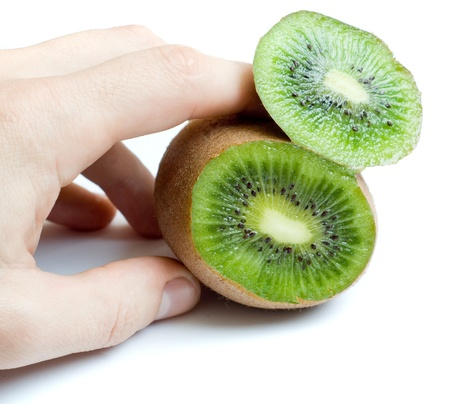 national fruit of china: Male hand holding cut kiwi section