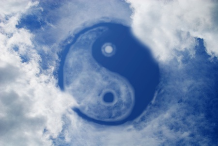 Yin and Yang sign in sky photo