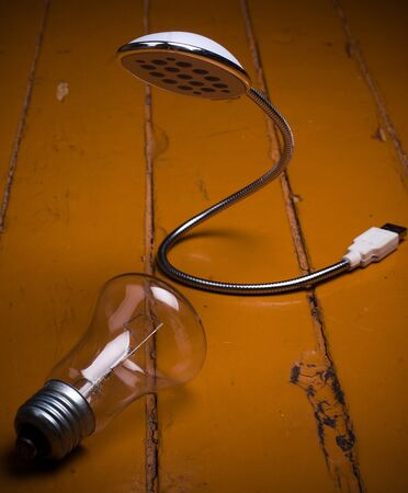 socle: old bulb and led lamp on floor. concept future Stock Photo