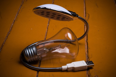socle: old bulb and led lamp on floor  concept future