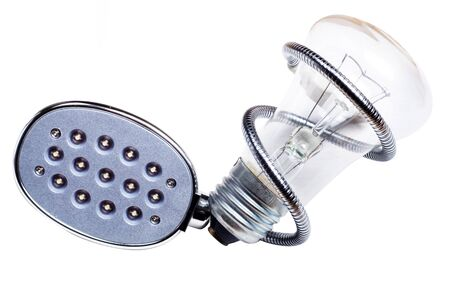 socle: old bulb and led lamp on paper  concept future Stock Photo