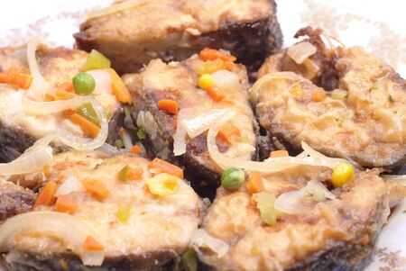 Salmon fried with vegetables and onion photo