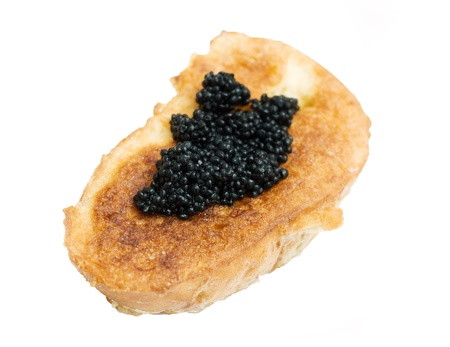 toast with black caviar on green dish,  isolated on white photo