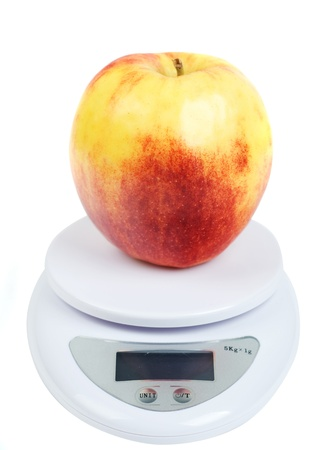 yellow red apple on scale Stock Photo - 13446742