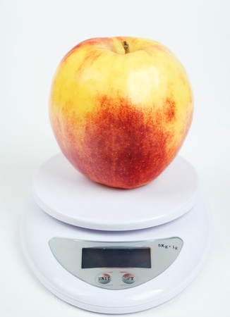 yellow red apple on scale photo