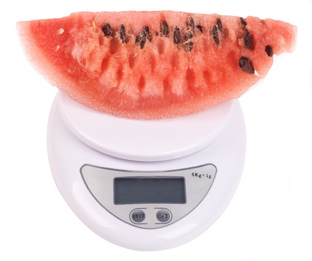 kitchen scale: watermelon in scale isolated on white Stock Photo