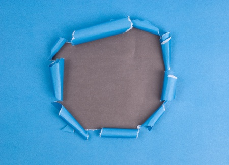 blue paper with hole of closeup photo