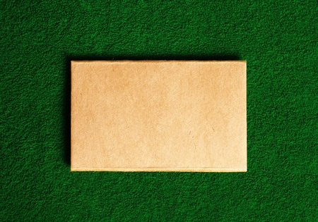 cardboard note on green grass background photo